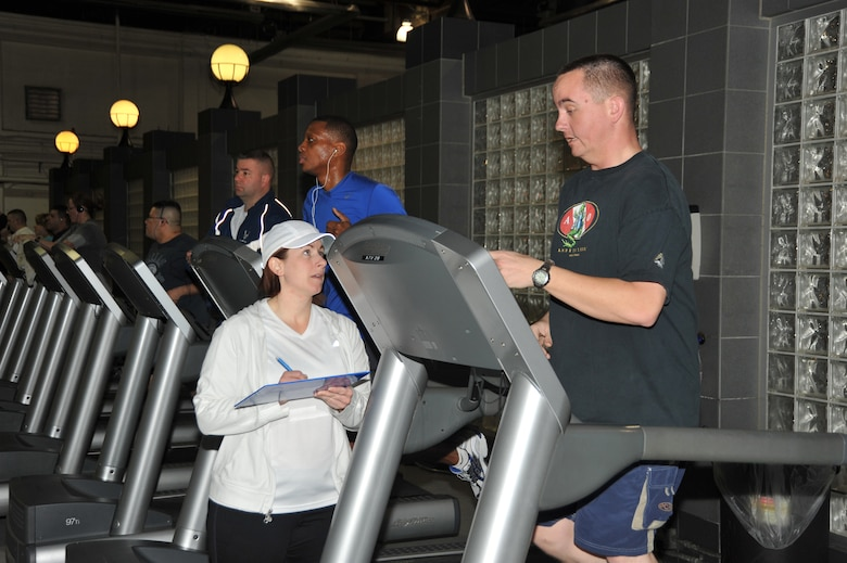 OFFUTT AIR FORCE BASE, Neb. - Marcy Jameson, HAWC Flight Chief & Exercise Physiologist, talks with Senior Airman Justin Speck of the 55th Logistic Readiness Squadron. Airman Speck was a participant in the Get Fit Run class at the Offutt Field House. U.S. Air Force photo by D.P. Heard