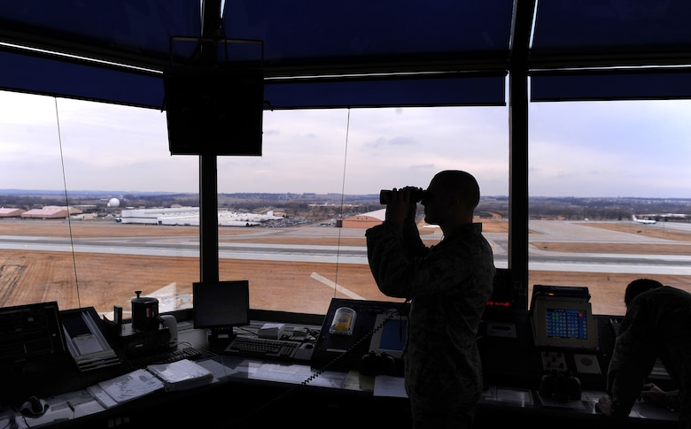OFFUTT AIR FORCE BASE, Neb. - Airman 1st Class Adam Karre, an air traffic controller apprentice assigned to the 55th Operations Support Squadron, monitors west bound incoming aircraft descending here, Feb. 24. U.S. Air Force Photo by Josh Plueger (Released)