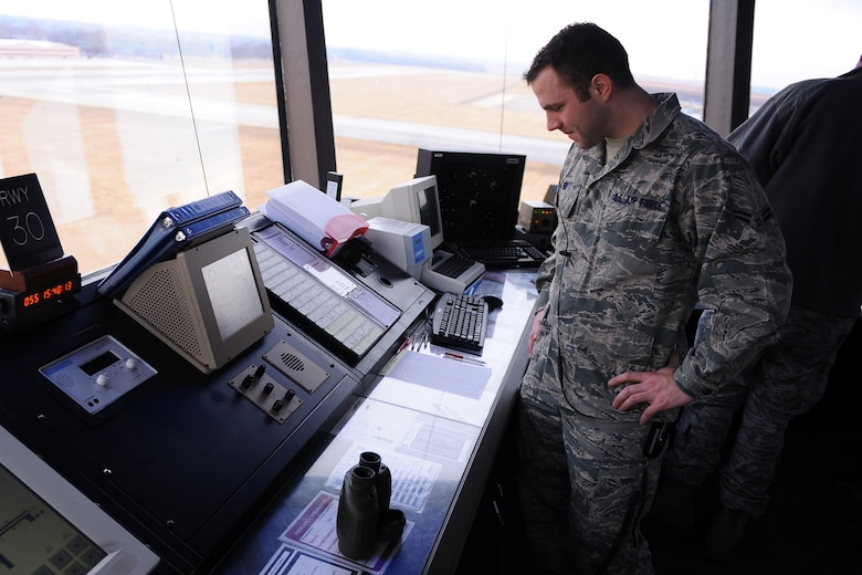 OFFUTT AIR FORCE BASE, Neb. - Airman 1st Class Mike Bier, an air traffic controller apprentice assigned to the 55th Operations Support Squadron, monitors aircraft traffic in and around Offutt, Feb. 24. U.S. Air Force Photo by Josh Plueger (Released)