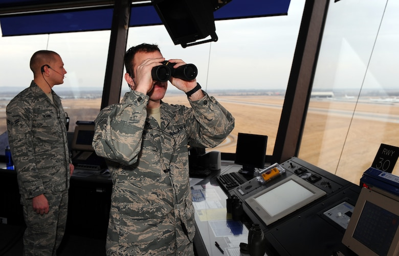 OFFUTT AIR FORCE BASE, Neb. - Airman 1st Class Mike Bier, an air traffic controller apprentice assigned to the 55th Operations Support Squadron, monitors east bound aircraft descending here, Feb. 24. U.S. Air Force Photo by Josh Plueger (Released)