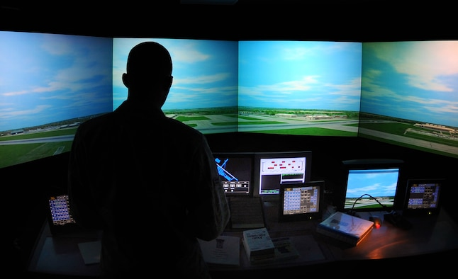OFFUTT AIR FORCE BASE, Neb. - Airman 1st Class Derrick Miller, an air traffic controller apprentice assigned to the 55th Operations Support Squadron, spends time in an air traffic control simulator with a 180 degree monitor with a detailed view of Offutt as part of routine training here, Feb. 24. U.S. Air Force Photo by Josh Plueger (Released)
