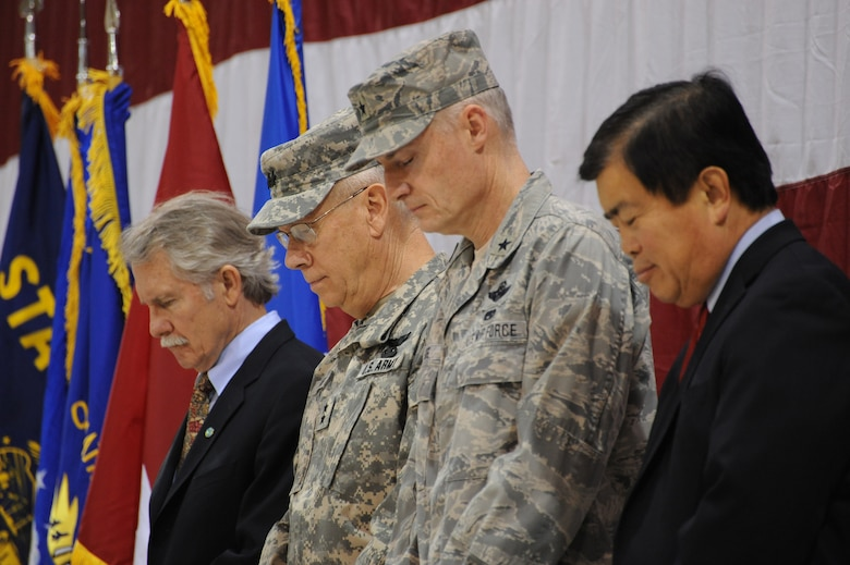 Oregon Governor John Kitzhaber, (Left to right) Maj. Gen. Raymond F. Rees, Adjutant General, Oregon, Brig. Gen. Steven Gregg, Commander of the Oregon Air National Guard, and Congressman David Wu (OR-District 1), pause for reflection during the Invocation of the 116th Air Control Squadron mobilization ceremony held at the Portland Air National Guard Base, Portland, Ore., on March 4, 2011. (U.S. Air Force photograph by Tech. Sgt. John Hughel, 142nd Fighter Wing Public Affairs)