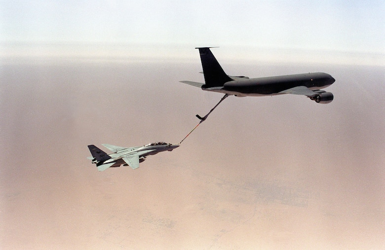 A KC-135 Stratotanker refuels a U.S. Navy fighter during air operations for Operation Desert Storm in January 1991. (Department of Defense Photo)