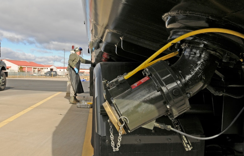 Staff Sgt. James Hubbard prepares to draw a sample of fuel from one of the tanker trucks used to transport fuel to the flightline and to the fleet of F-15 aircraft at Kingsley Field.