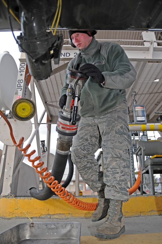 Staff Sgt. Colin Carr pumps prepares to fill a waiting tanker truck before taking it to the flightline to refuel jets returning from missions flown in the morning.