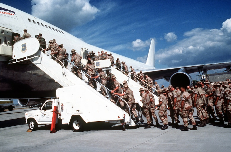 Marines headed to support the coalition forces participating in Operation Desert Shield board a commercial aircraft chartered by the Military Airlift Command in September 1991. (Department of Defense Photo)