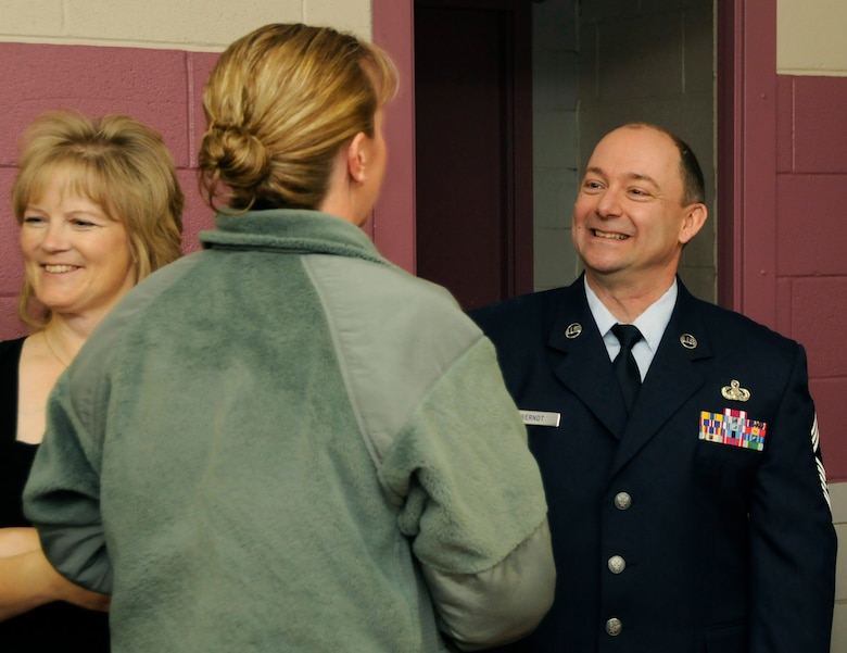 Chief Master Sgt. Todd Berndt, 173rd Communications Squadron, is congratulated by members of the 173rd Fighter Wing during a promotion ceremony, Feb. 5, 2011, at Kingsley Field in Klamath Falls, Ore.
