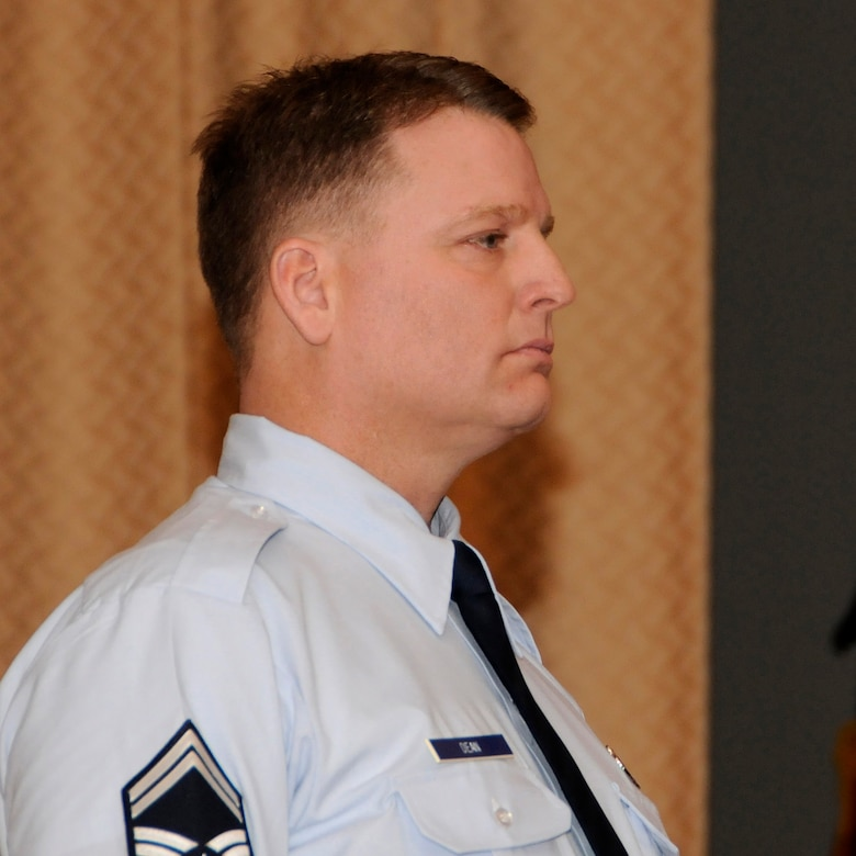 Senior Master Sgt. James Dean of the 173rd Aircraft Maintenance Squadron stands at attention as his promotion orders are read for the assembled members of the 173rd Fighter Wing during a promotion ceremony, Feb. 5, 2011, at Kingsley Field in Klamath Falls, Ore.