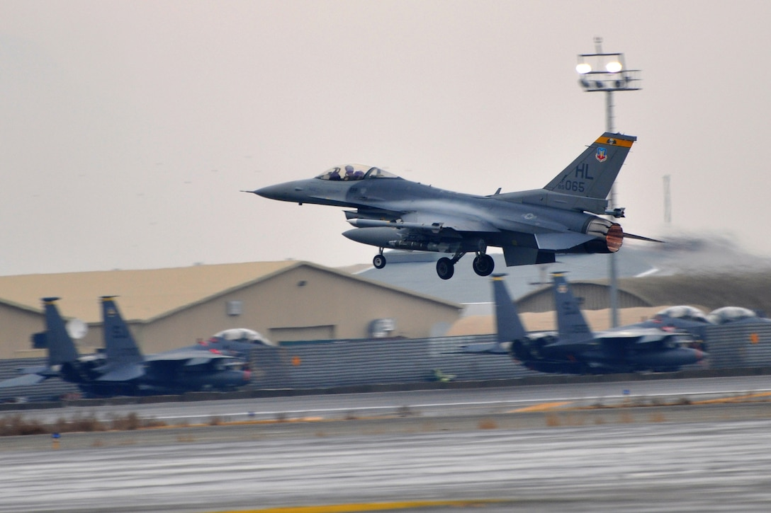 An F-16 Fighting Falcon belonging to the 4th Expeditionary Fighting Squadron takes off from Bagram Airfield, Afghanistan, March 9, 2011. The 4th EFS launch F-16s around the clock in support of Operation Enduring Freedom. (U.S. Air Force photo by Capt. Erick Saks)