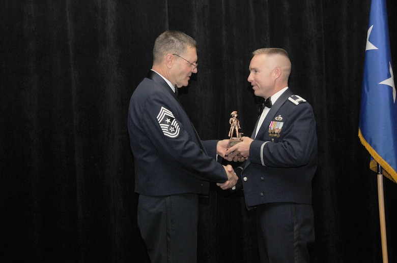 Capt. Jason Burns from the 162nd Fighter Wing, Tucson Ariz, is the Arizona Air National Guard's Maj. Gen. Donald L. Owens Award winner. Captain Burns accepts his award from Arizona State Command Chief Daniel Irving on Saturday March 5, 2011.  (U.S. Air Force photo by Airman 1st Class Rashaunda Williams/Released)