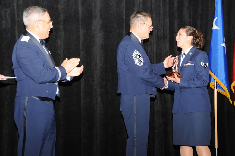 Senior Airman Amanda Gast from the 214th Reconnaissance Group, Tucson Ariz, is the Arizona Air National Guard's Airman of the Year.  Airman Gast accepts her award from Arizona State Command Chief Daniel Irving and Brig. Gen. Michael Colangelo, Commander, Arizona Air National Guard on Saturday March 5, 2011.  (U.S. Air Force photo by Airman 1st Class Rashaunda Williams/Released)