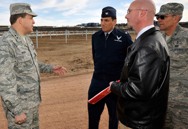 Maj. Gen. Timothy Byers speaks with Col. Rick LoCastro, Russ Hume and Col. Gregory Seely during a visit to the Air Force Academy's solar array March 4, 2011. The array is scheduled to generate its first megawatt of power in March and ramp up to its full 6MW capacity by the end of April. General Byers is the Air Force Civil Engineer and graduate of the University of Kentucky. Colonel LoCastro is the Academy's 10th Air Base Wing commander. Colonel Seely is the director of Installation and Mission Support, and Mr. Hume is an engineer with the A7 directorate. (U.S. Air Force photo/Bill Evans)
