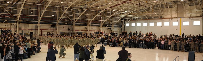 Soldiers for the 105th Military Police Company, New York Army Guard received a standing ovation as they entered the hangar for sendoff ceremony. More than 115 Soldiers have been training for more than a year in preparation for a yearlong deployment as a Police Transition Team to Iraq.  According to the 105th MP Company Commander Capt. John Vanlaningham the Soldiers are ready to deploy, highly motivated and ready to get the mission done. While in theatre the Soldiers will conduct a variety of missions such as training Iraqi police forces, escorting convoys and dignitary security.  (U.S. Air Force photo/Staff Sgt. Peter Dean)