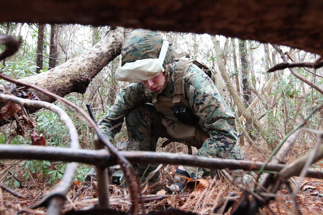 Corporal Timothy Dorsey, a sensor surveillance operator with the 22nd Marine Expeditionary Unit, carefully covers surveillance equipment during an operational check aboard Marine Corps Base Camp Lejeune, N.C., March 10, 2010. This equipment will survey areas of interest during the MEU's upcoming deployment. The Marine and sailors of the 22nd MEU are currently participating in their pre-deployment training program, which is a series of progressively complex exercises designed to train and test the MEU's ability to operate as a cohesive and effective Marine Air Ground Task Force.