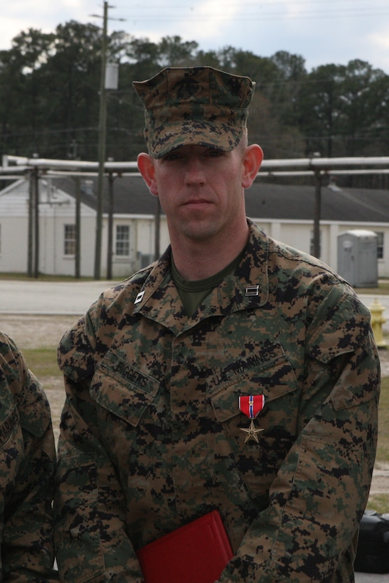 Capt. Joshua Biggers, executive officer of the Infantry Training Battalion, School of Infantry – East, stands after receiving the Bronze Star Medal with V following his award ceremony aboard Camp Geiger, March 11. As commanding officer of Company K, 3rd Battalion, 6th Marine Regiment, Regimental Combat Team 7, 1st Marine Division (Forward), in Marjah, Afghanistan, Biggers displayed multiple acts of heroism in leading his Marines and sailors during the six-month Operation Moshtarak.