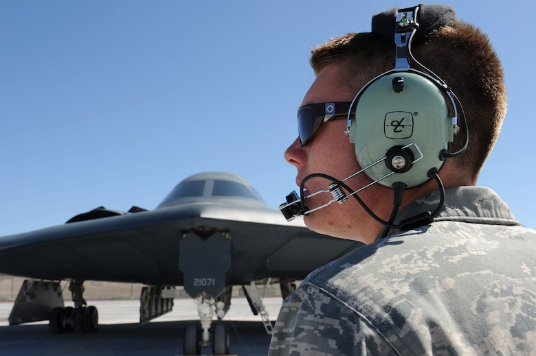 NELLIS AIR FORCE BASE, Nev., --  Senior Airman Mark Dixon, 509th Aircraft Maintenance Squadron crew chief, from Whiteman Air Force Base, Mo., communicates through his headset with a B-2 Spirit pilot during Red Flag 11-3 at Nellis Air Force Base, March 8. Red Flag is a realistic combat training exercise for the United States  and its allies. During Red Flag,  military units are able to test their skill and firepower over the Nevada Test and Training Range. (U.S. Air Force photo by Staff Sgt. Taylor Worley)