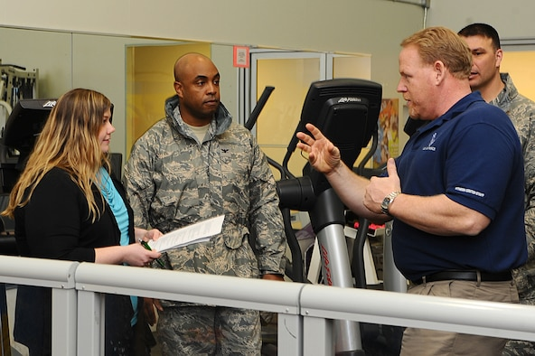 (Right) Retired Chief Master Sgt. Rick Ives, 28th Force Support Squadron fitness center director, explains upcoming changes at the Bellamy Fitness Center to Col. Trent Edwards, 28th Mission Support Group commander, and Mandy Morford, monitor of the spouses' Facebook page at Ellsworth Air Force Base, March 01, 2011. Mrs. Morford spent the day shadowing Colonel Edwards as he answered questions from the spouses' group on base. (U.S. Air Force photo/Senior Airman Kasey Close)