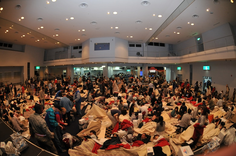 YOKOTA AIR BASE, Japan -- Delta Airline passengers take shelter inside the Taiyo Community Center here March 11. American Red Cross volunteers provided blankets, pillows, food and water for aircraft passengers whose planes were diverted from Narita International Airport, Tokyo, Japan, following an earthquake near Tokyo. (U.S. Air Force photo/Airman John D. Partlow)