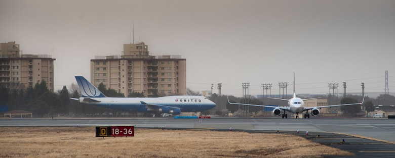 YOKOTA AIR BASE, Japan -- Commercial aircraft land on the flightline here March 11, after diverting from Narita International Airport, Tokyo, Japan. The base opened its airfield to commercial aircraft after an earthquake hit near Tokyo. (U.S. Air Force photo/Staff Sgt. Samuel Morse)