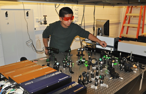 Graduate student Huarui Sun performs sensitive measurement of