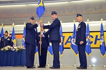 U.S. Air Force Lieutenant General Charles E. Stenner Jr., Chief of Air Force Reserve, Headquarters U.S. Air Force, Washington, D.C. and Commander, Air Force Reserve Command, Robins Air Force Base, Ga., presents Brigadier General Mark A. Kyle with the 4th Air Force guidon.  General Kyle is assumed command of 4th Air Force from Major General Eric W. Crabtree on March 12, 2011.  (U.S. Air Force photo by Technical Sgt. Christine Jones) (released)