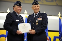 U.S. Air Force Lieutenant General Charles E. Stenner Jr., Chief of Air Force Reserve, Headquarters U.S. Air Force, Washington, D.C. and Commander, Air Force Reserve Command, Robins Air Force Base, Ga., presents Major General Eric W. Crabtree with the Distinguished Service Medal during a change of command ceremony at March Air Reserve Base, Calif., March 12, 2011.  (U.S. Air Force photo by Technical Sgt. Christine Jones) (released)
