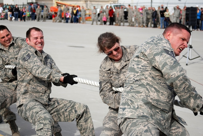Members of the Utah Air National Guard's maintenance squadron strain to pull a KC-135 Stratotanker during Winter Wingman Day 2011 at the Utah Air National Guard base on March 12. Three teams, of 15 people each, compete against the clock to see which team can rope-pull a 120,000 pound Stratotanker, a distance of 40 feet, the fastest. (U.S. Air Force photo by Senior Master Sgt. Sterling Poulson)(RELEASED)