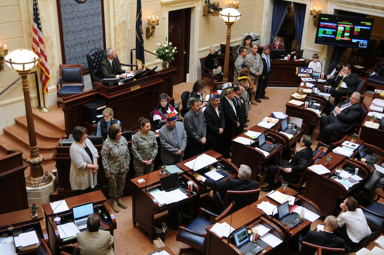 Current and former military members serving from World War II to present day stand in front of the Utah State Senate floor during Latino Appreciation Day Feb. 16, 2011, at the Utah State Capitol in Salt Lake City. The Utah National Guard's highest ranking Hispanic members Lt. Col Frances Marcus, and Chief Warrant Officer 5 Fabian Salazar, Utah National Guard, and Maj. Krista DeAngelis and Chief Master Sgt. Corey Quintana, Utah Air National Guard, were recognized during the ceremony. (U.S. Air Force photo by Tech. Sgt. Kelly Collett)(RELEASED)