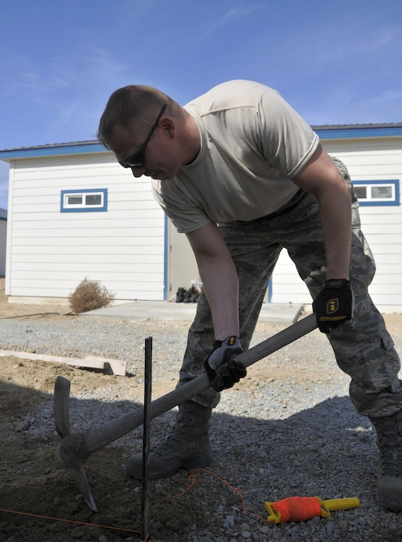 SAN CLEMENTE ISLAND, Calif. -- Tech. Sgt. Bryan S. Spake, an entomology specialist with the Alaska Air National Guard's 176th Civil Engineer Squadron (176 CES), prepares groundwork here March 12 for setting concrete forms.A native of South Hill, Va., Spake deployed to this remote location off the coast of southern California for training with his Air National Guard unit. The 176 CES, part of the Alaska Air National Guard's 176th Wing, deployed to San Clemente Island for two weeks in March 2011 to train and work on a variety of infrastructure projects.Alaska Air National Guard photo by Staff Sgt. N. Alicia Goldberger.