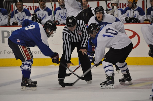 JOINT BASE MCGUIRE-DIX-LAKEHURST, N.J. - Players from the Joint Base McGuire-Dix-Lakehurst All Stars and Dover All Stars ready for play at the 4th Annual Dover/JB MDL Charity Ice Hockey fundraiser game held March 12 at the Wells Fargo Center in Philadelphia, Pa. The teams raised $1,250 for the Combined Federal Campaign Airmen Memorial Foundation.(U.S. Air Force photo/Master Sgt. Donna T. Jeffries)