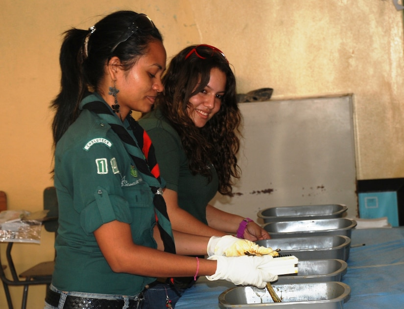 SOTO CANO AIR BASE, Honduras - Members of the Scouts of Honduras, Troop 14, clean and sterilize dental equipment at a Medical Readiness and Training Exercise in Choluteca Mar. 11, held there to assist the Honduran Ministry of Health in providing basic medical services to residents of the area.  JTF-Bravo routinely conducts training exercises throughout Central Americal to ensure regional stability as well as to our ability to respond to natural disasters, provide humanitarian assistance, and protect the vital interests of the United States. (U.S. Air Force photo/Capt. John T. Stamm)