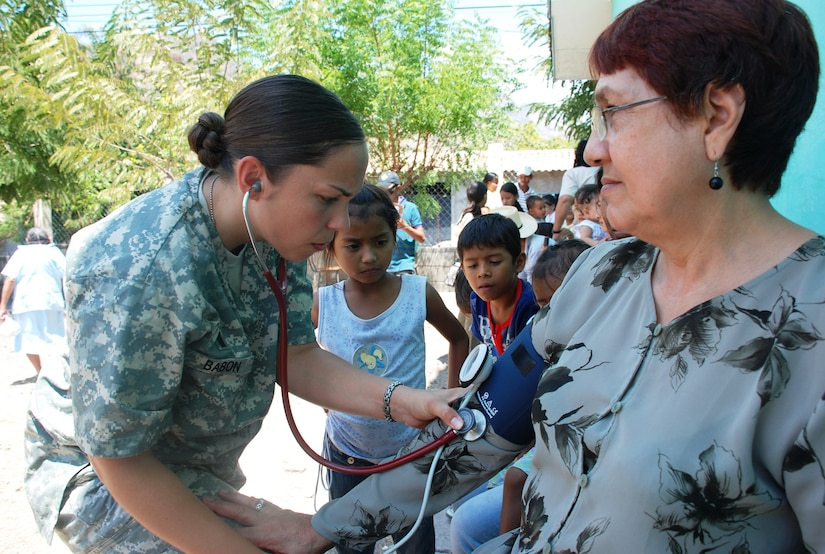 SOTO CANO AIR BASE, Honduras - 1Lt. Eilleen Babon, Joint Task Force-Bravo Medical Element nurse, checks the blood pressure of a patient in Choluteca Mar. 11.  Lieutennant Babon was part of a Medical Readiness and Training Exercise held there to assist the Honduran Ministry of Health in providing basic medical services to residents of the area.  JTF-Bravo routinely conducts training exercises throughout Central Americal to ensure regional stability as well as to our ability to respond to natural disasters, provide humanitarian assistance, and protect the vital interests of the United States. (U.S. Air Force photo/Capt. John T. Stamm)