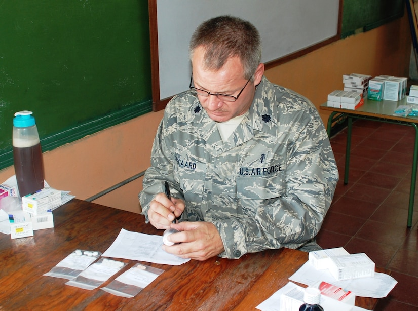 SOTO CANO AIR BASE, Honduras - Lt. Col. Douglas Odegard, Joint Task Force-Bravo Medical Element Ancillary Services officer, fills a perscription at a make-shift pharmacy in Choluteca Mar. 11.  Colonel Douglas was part of a Medical Readiness and Training Exercise held there to assist the Honduran Ministry of Health in providing basic medical services to residents of the area.  JTF-Bravo routinely conducts training exercises throughout Central Americal to ensure regional stability as well as to our ability to respond to natural disasters, provide humanitarian assistance, and protect the vital interests of the United States. (U.S. Air Force photo/Capt. John T. Stamm)