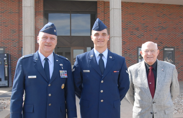 Airman Donald Noah, a former 315th Training Squadron student, his father Col. Donald Noah and his grandfather Ret. Col. Donald Owen Noah, pose after the Airman's graduation ceremony at the Base Theatre, Feb. 14. (U.S. Air Force photo/Senior Airman Anne Gathua)