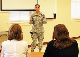Graduates of Resilient Spouse Academy listen to Brig. Gen. Rhonda Cornum, Director of Comprehensive Soldier Fitness, January 2011.  More information about future sessions of the training available on ACS web page.
