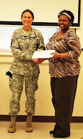 Graduates of Resilient Spouse Academy are congratulated by Brig. Gen. Rhonda Cornum, Director of Comprehensive Soldier Fitness, January 2011.  More information about future sessions of the training available on ACS web page.