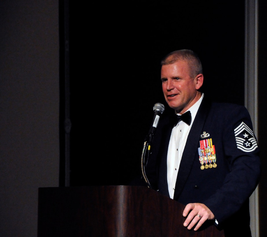 Chief Master Sgt. Harold Clark, 12th Air Force (Air Forces Southern) command chief, introduces the night's guest speaker, Former Chief Master Sergeant of the Air Force Rodney Mckinley, to the 12th AF Outstanding Performer of the Year banquet attendees in Las Vegas Feb. 23.