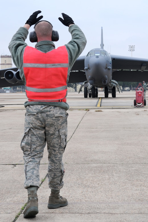 Senior Airman Jarod Feller, 707th Maintenance Squadron crew chief, marshals a 2nd Bomb Wing B-52H, call sign Skull 61, back to its parking spot following its return from a nuclear training mission at Barksdale Air Force Base, La, March 5, 2011. The 707th MXS is an Air Force Reserve classic associate unit assigned to the 2nd Bomb Wing maintenance group and supports the 343rd Bomb Squadron. The launch of this crew and aircraft was significant for being the first supported by 2nd BW operations and maintenance personnel during a 307th Bomb Wing Reserve Unit Training Assembly. (U. S. Air Force Photo/Master Sgt. Greg Steele)