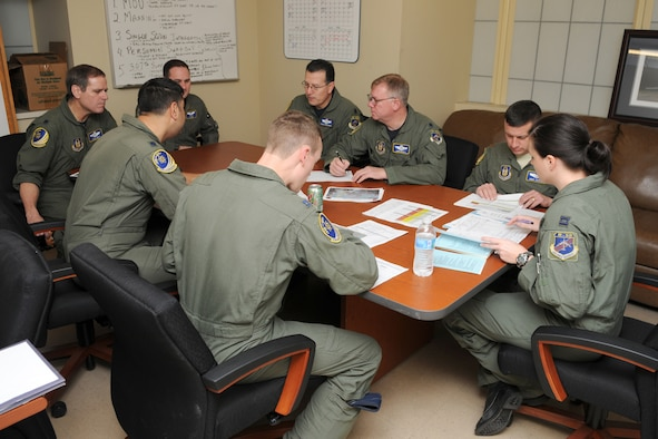 The crew of sortie Skull 61, all Air Force Reservists assigned to the 343rd Bomb Squadron, assembles for a pre-flight briefing prior to take off on a morning B-52H training mission at Barksdale Air Force Base, La, March 5, 2011. The mission simulated the release of both nuclear Air Launched Cruise Missiles and gravity bombs. The launch of this crew and aircraft was significant for being the first supported by 2nd Bomb Wing operations and maintenance personnel during a 307th Bomb Wing Reserve Unit Training Assembly. The 343rd BS is a classic associate unit assigned to the 2nd BW. (U. S. Air Force Photo/Master Sgt. Greg Steele)