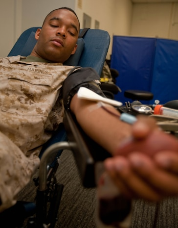 Cpl. Deandre A. Simms-Aguilar, an administration clerk with Headquarters and Service Battalion, U.S. Marine Corps Forces, Pacific, donates blood during a blood drive March 16 here. Donations to Armed Services Blood Program ensure service members and their families have the blood needed to treat numerous blood disorders, conduct surgical procedures and save lives.