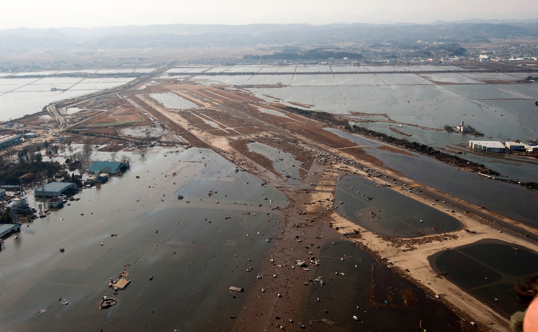 Debris and water covers most of the Sendai Airport, Japan, March 13, 2011, after the 8.9-magnitude earthquake and subsequent tsunami that struck the region. (U.S. Air Force photo/Staff Sgt. Samuel Morse)