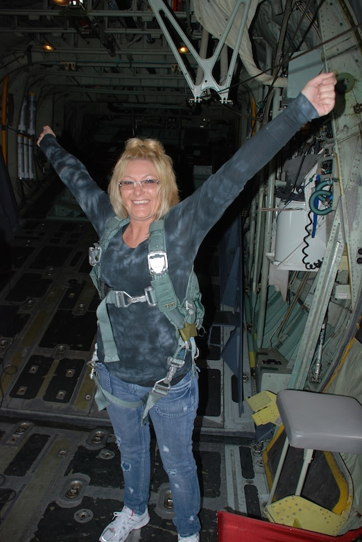 PATRICK AIR FORCE BASE, Fla. - A wife of a 920th Rescue Wing Reservist here shows her excitement on board an HC-130P/N King airplane before taking off. Col. Robert Dunn, 920th RQW Commander, invited spouses of the Air Force Reservists here to participate in special flights on HH-60G Pave Hawk helicopters and the King airplanes. This event allowed the husbands and wives of hard-working Reservists a glimpse into their drill training weekends and the aircraft they work to maintain. (U.S. Air Force photo/Capt. Ryan Liss)