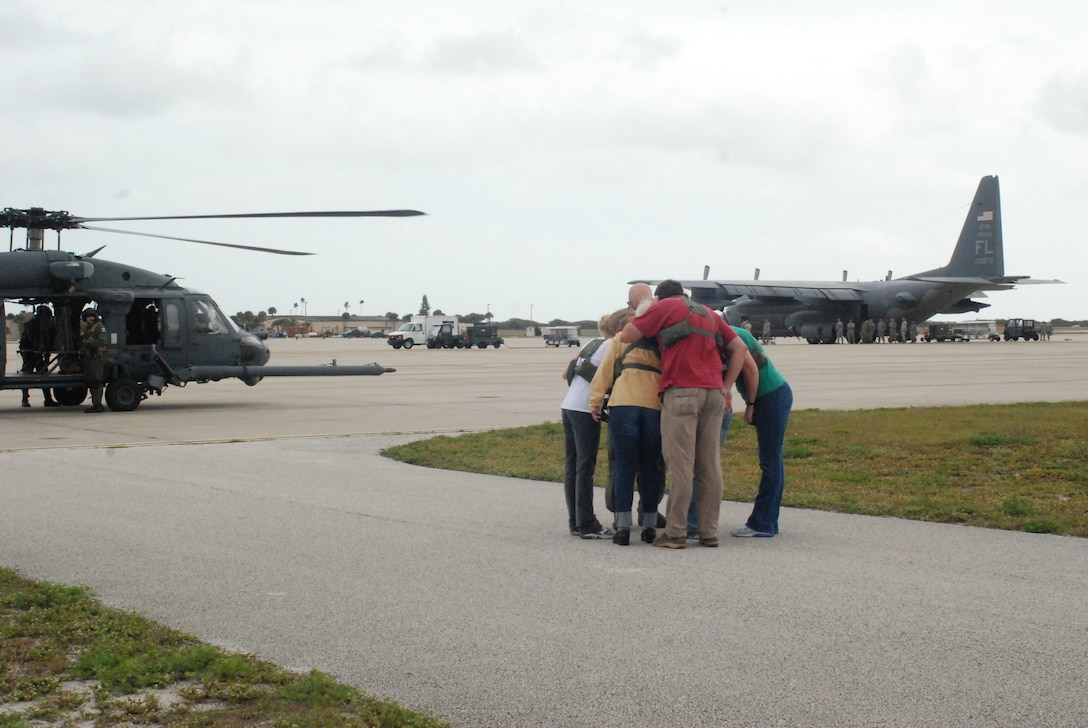 PATRICK AIR FORCE BASE, Fla. - A group of spouses huddled around an HH-60G Pave Hawk helicopter pilot as he gave them a flight brief before getting on board the helicopter. Col. Robert Dunn, 920th Rescue Wing Commander, invited spouses of the Air Force Reservists here to participate in special flights on the Pave Hawk helicopters and HC-130 P/N King airplanes. This event allowed the husbands and wives of hard-working Reservists a glimpse into their drill training weekends and the aircraft they work to maintain. (U.S. Air Force photo/Airman First Class Natasha Dowridge)