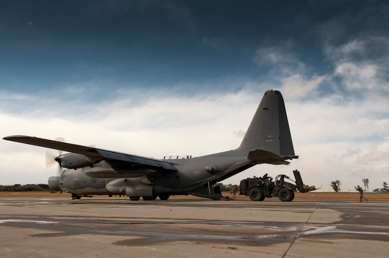 SENDAI AIRPORT, Japan -- Airmen unload supplies and a forklift from a MC-130H Combat Talon II here March 16. This is the first fixed-wing aircraft to land at the airport since an earthquake and tsunami crippled much of the Japanese eastern seaboard March 11. The opening of this runway to fixed-wing aircraft by the 320th Special Tactics Squadron and Japanese emergency management organizations provides a critical means of transporting fuel, equipment, food and other supplies to areas affected by the earthquake and tsunami. (U.S. Air Force photo/Staff Sgt. Samuel Morse)