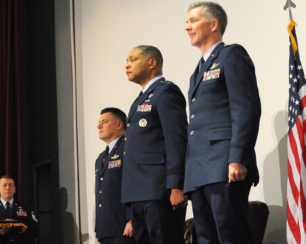 Col. Peter Stavros (left), Maj. Gen. Garry Dean (center) and Col. Paul Gruver (right) stand at attention during the Western Air Defense Sector change of command ceremony March 4.