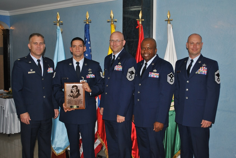SOTO CANO AIR BASE, Honduras - 612th Air Base commander Lt. Col. Cade, Tech. Sgt. Antonio Araiza, 612th ABS senior enlisted Chief Master Sgt. Schwenk, 612th ABS first sergeant Master Sgt. Emmit Bartee and Senior Master Sgt. Ricky Herring take a photo together after Sergeant Araiza is recognized as the John Levitow Award winner during the Non-Commissioned Officer Academy graduation in Bogoata, Colombia Mar. 3. Sergeant Araiza went to the academy from the 612 Air Base Squadron and completed the 228-hour course entirely in Spanish. Joint Task Force-Bravo and Soto Cano Air Base are committed to full partnerships with Central American governments in training and missions to support security, stability and prosperity throughout the region. (U.S. Air Force photo/Master Sgt. Emmit Bartee)
