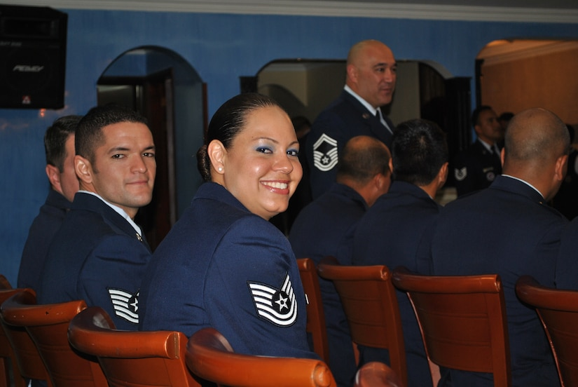 SOTO CANO AIR BASE, Honduras - Tech Sgts. Antonio Araiza and Rebeca Rosado take their seats and prepare for graduation from the Non-Commissioned Officer Academy in Bogoata, Colombia Mar. 3. Sergeant Araiza went to the academy from the 612 Air Base Squadron, completed the 228-hour course entirely in Spanish and was recognized as both Distinguished Graduate and John Levitow Award winner. Joint Task Force-Bravo and Soto Cano Air Base are committed to full partnerships with Central American governments in training and missions to support security, stability and prosperity throughout the region. (U.S. Air Force photo/Master Sgt. Emmit Bartee)