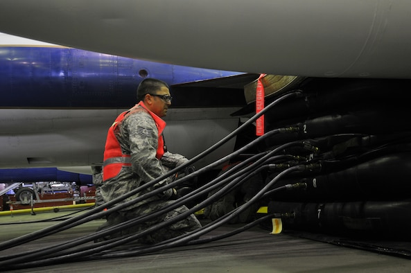 Tech. Sgt. David Chavez, an aircraft maintenance technician assigned to the 129th Maintenance Squadron, observes the airbag that raises the right wing of a TF-104G aircraft. Airmen from the 129th Rescue Wing conducted a full-scale airbag lift exercise using a TF-104G static display to simulate a downed aircraft at Moffett Federal Airfield, Calif., Mar. 15, 2011.  (Air National Guard photo by Tech. Sgt. Ray Aquino/RELEASED)  More information about the TF-104G is available at http://www.nationalmuseum.af.mil/factsheets/factsheet.asp?id=2313.