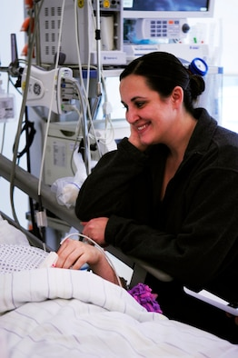 Amanda Schneider talks with her husband Staff Sgt. Kris Schneider as he recovers from injuries sustained during the March 2, 2011, shooting at the Frankfurt International Airport, Germany. The RAF Lakenheath 48th Security Forces Squadron Airman was being treated at the Johann Wolfgang Goethe University Hospital in Frankfurt am Main. (U.S. Air Force photo by Tech. Sgt. Jocelyn L. Rich)