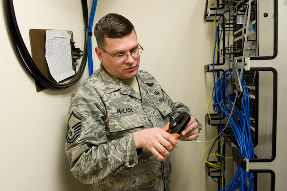 JOINT BASE ELMENDORF-RICHARDSON, Alaska - Master Sgt. Barron McLain, a client support technician with the 176th Communications Flight, makes and installs telephone patch cables. The flight recently moved -- along with its parent unit, the 176th Wing -- from Kulis Air National Guard Base to Joint Base Elmendorf-Richardson, per the 2005 Defense Base Closure and Realignment proposal. Since January, McLain, a handful of other technicians from the flight, and two Alaska Military Youth Academy cadets installed more than 600 telephones throughout 14 Guard facilities here. Alaska Air National Guard photo by Master Sgt. Shannon Oleson.